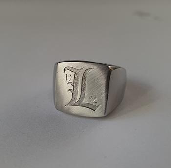 handgravyr-klackring-symbol-bokstav